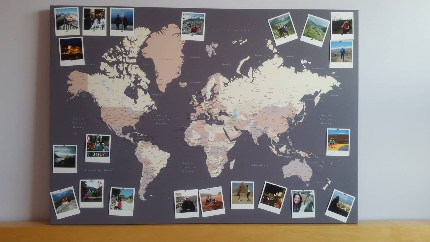 pinboard world map pinned with photos